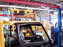 Overhead Monorail System with hydropneumatic swivel and lifting station in a paint shop and the assembly area of a car cabin manufacturer